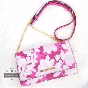 Michael Kors Bags - NWT Michael Kors Jet set granita pink crossbody
